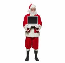 抱着笔记本电脑圣诞老人图片